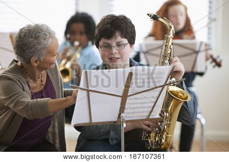 Student learning to play the saxophone