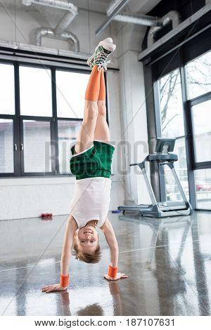 Adorable Kid Boy In Sportswear Training At Fitness Studio, Children Sport Concept