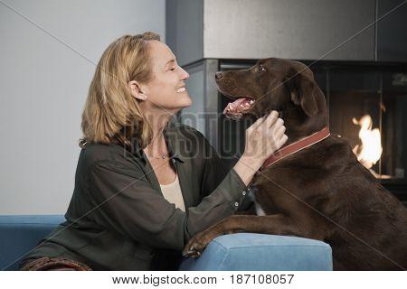 Caucasian woman petting dog