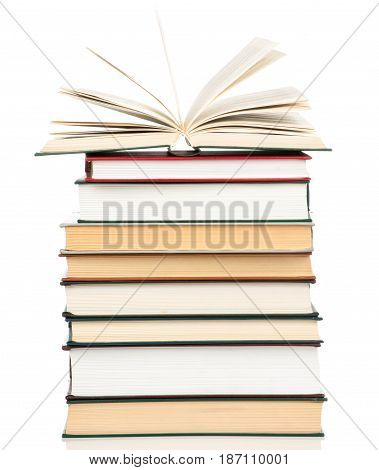 Photo of a book heap isolated on white background