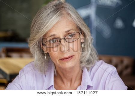 Close up of worried senior woman looking away