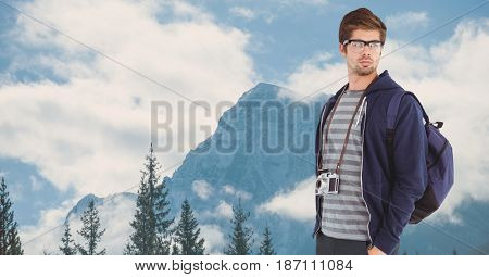 Digital composite of Handsome man traveling on mountains