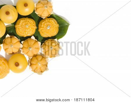Sweet yellow dessert royal Thai cuisine decorated with green leaf on solid white background