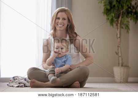 Caucasian mother holding son on lap