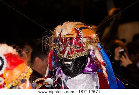 Quito, Ecuador - february 02, 2016: Close up of an unidentified people dressed up participating in the Diablada.