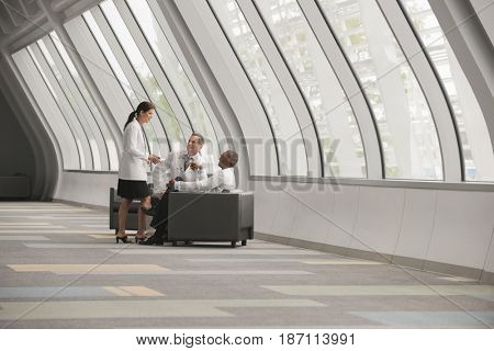 Doctors talking together in hospital corridor