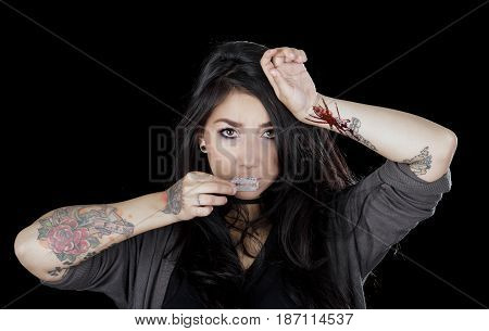 Quito, Ecuador - May 09, 2017: Sad teenager with her arm injuried by a gillette, bue whale challenge, social suicide concept as a sociology metaphor for crowd or herd mentality and group decisions resulting in violence or population death as a network of