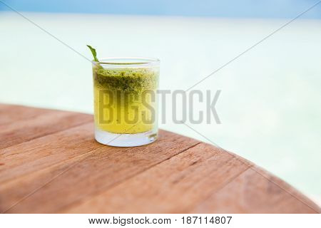 drinks concept - glass with drink or mohito cocktail on bar table