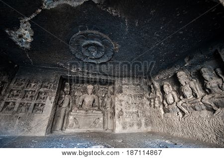 Ellora Caves UNESCO World Heritage Site. Statue of big Buddha sanctuaries devoted to Buddhism Hinduism and Jainism. Temples and monasteries near Aurangabad.