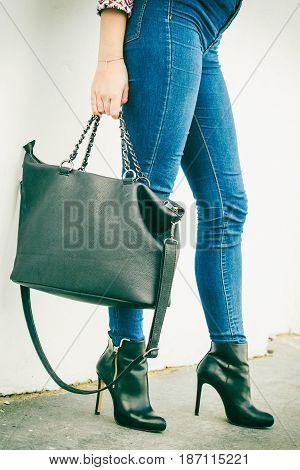 Woman Legs In Heels Shoes Handbag In Hand