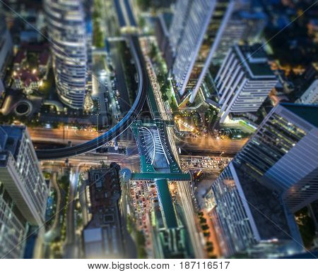 Aerial view of Central Business district CBD of Bangkok on Sathorn road shooting on twilight sunsets Tilt-shift effect.
