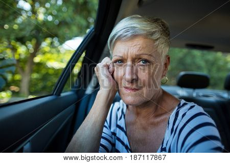 Portrait of tensed senior woman siting in car