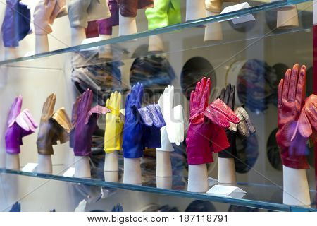 VENICE ITALY - SEPTEMBER 24 2010: bright gloves on a window of shop