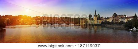 Prague - Vltava Embankment and Charles Bridge the Czech Republic. Sunset