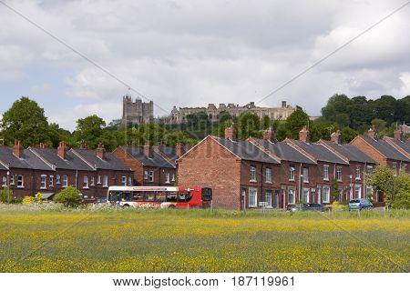Bolsover Derbyshire - Feb 01: A bus stops before terraced village homes in Bolsover on 01 Feb 2014 in Bolsover Derbyshire UK