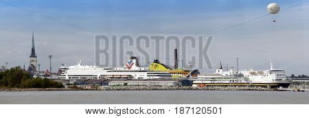 TALLINN ESTONIA- SEPTEMBER 7 2015: Cruise ship in port with old town and balloon in background on September 7 2015 in Tallinn Estonia