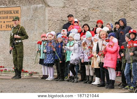 Kirishi, Russia - 9 May, Teens with flowers, 9 May, 2017. Holding a festive rally dedicated to the Victory Day.
