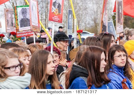 Kirishi, Russia - 9 May, People under portraits, 9 May, 2017. Holding a festive rally dedicated to the Victory Day.
