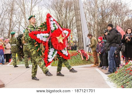 Kirishi, Russia - 9 May, People with a wreath in the form of a star, 9 May, 2017. Laying wreaths and flowers in memory of the fallen at the Eternal Flame.