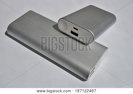 Macro detail of silver aluminum power banks (external batteries) in modern slick design used as an external source of energy