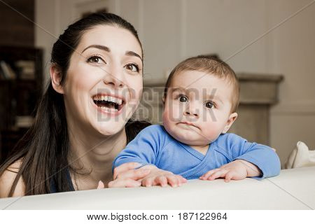 Mother With Son Spending Time Together And Laughing At Camera