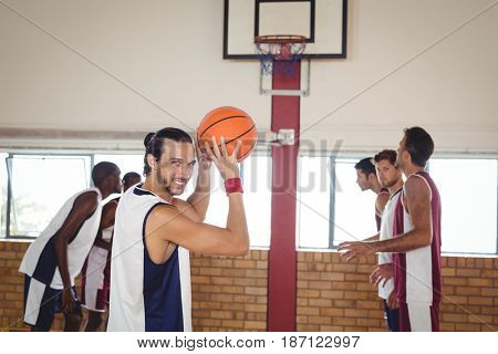 Basketball player about to take a penalty shot while playing basketball