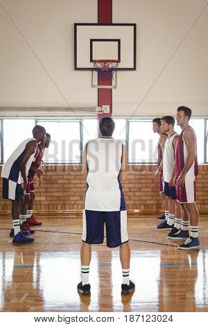 Basketball player about to take a penalty shot while playing basketball in the court