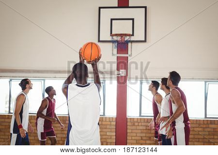 Basketball player taking a penalty shot in basketball court
