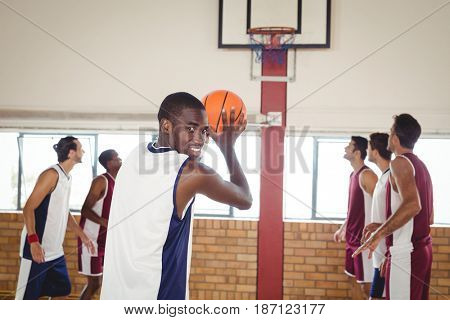 Portrait of basketball player taking a penalty shot