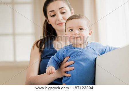 Happy Young Family Of Two People Relaxing At Home. Mother With Her Son Spending Time Together