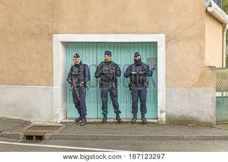 DIGNE FRANCE - MAR 24 2017: policemen protect the ceremony at a church to remember dead people of the German wings accident.
