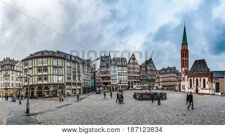 FRANKFURT GERMANY - JAN 13 2017: people visit the Roemerberg the main market place at historic Frankfurt.