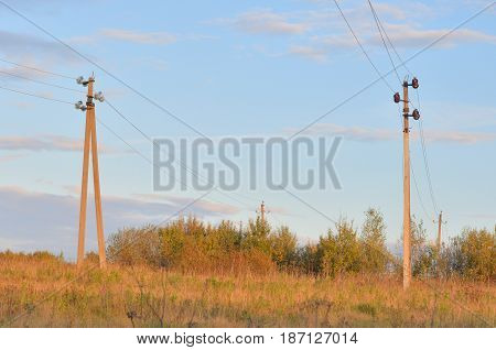 Electric power transmission lines at evening Russia.