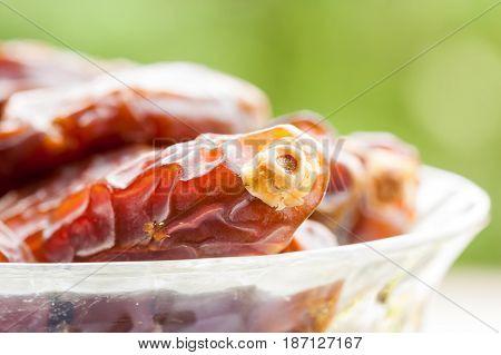 Closeup of Date fruits in glass bowl. Ramadan, Eid concept