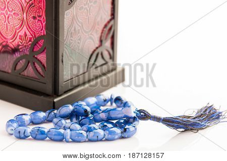 Blue Islamic Rosary with Arabic lantern as background
