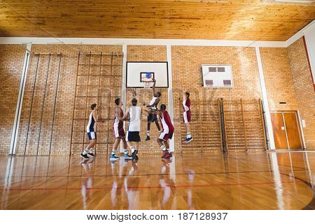 Player scoring a goal while playing basketball in the court