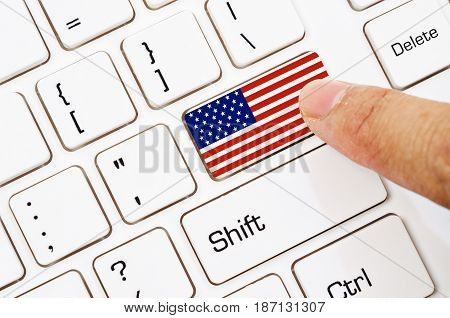 Hand press Computer keyboard with the US flag on it.