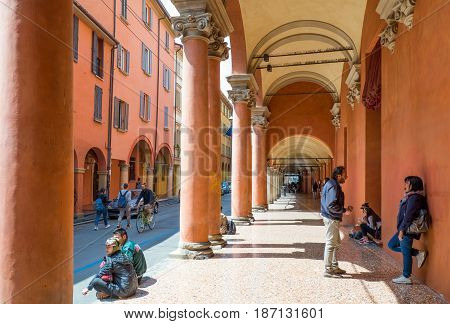 Bologna Italy - May 5 2016: Students under the arcades of the University district