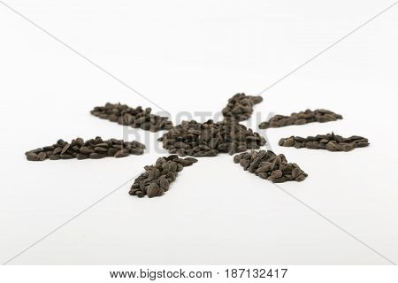 Black Fried Sunflower Seeds On A White Background.