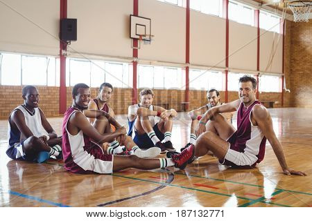 Portrait of smiling basketball player relaxing in the court