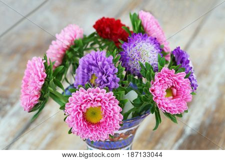 Colorful daisy bouquet on rustic wooden surface