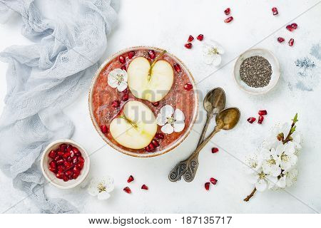 Healthy breakfast set. Acai superfoods smoothies bowl with chia seeds pomegranate sliced apples and honey. Overhead top view flat lay copy space. Traditional food of jewish New Year - Rosh Hashana.