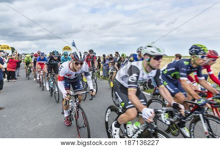Ardevon France - July 2 2016: Froomey of Team Sky in the peloton taking the start of Tour de France at Km 0 close to Mont Saint Michel Monastery in ArdevonFrance on July 22016.