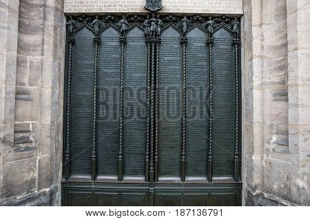 Door of the All Saints church in Wittenberg Germany with the ninety-five theses posted by Martin Luther