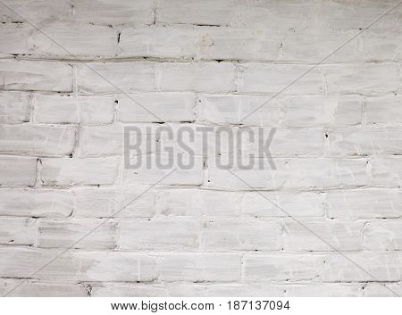 White bricks wall background. Retro building texture - bricks with aged white paint stains. Construction wallpaper with empty place for text.