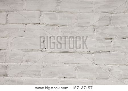 White bricks wall background. Retro building texture - bricks with aged white painting.  Construction wallpaper with empty place for text.