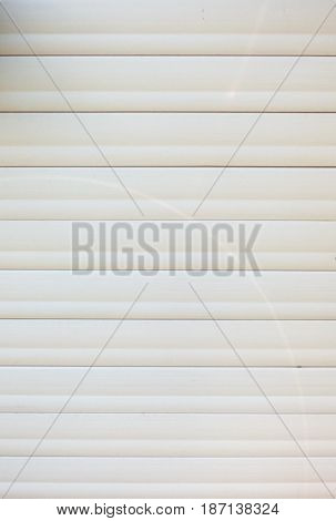 Aged white wall panels texture. Plastic wall background. Construction wallpaper with empty place for text. Closeup view of horizontal structure.