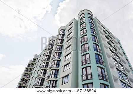 Balcony Of New Modern Turquoise Multi Storey Residential Building House In Residential Area On Sunny