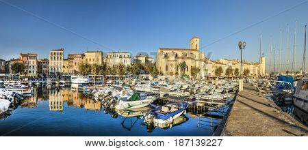 Yachts Reflecting In Blue Water In The Old Town Port Of La Ciotat, Marseilles District, France, In T