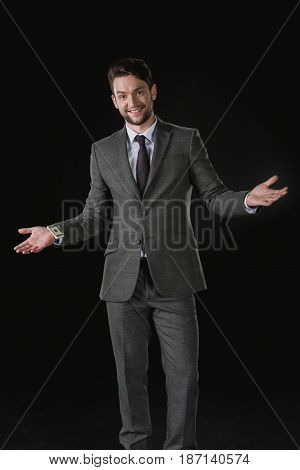 Young Smiling Businessman With Dollar Banknotes In Sleeve Isolated On Black